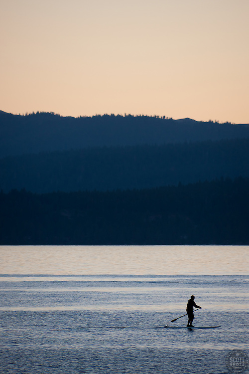 """Paddle Boarder on Lake Tahoe 2"" - This stand up paddle boarder was photographed at sunset from Speedboat Beach, Lake Tahoe."