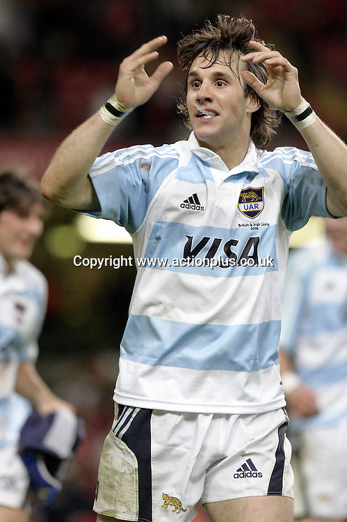 23 May 2005: Argentina full back Bernardo Stortoni celebrates a famous result at the end of game against The British Lions played at the Millennium Stadium. The game finished 25-25. Photo: Steve Bardens/actionplus<br /> <br /> 050523 rugby player joy celebrate celebration