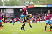 Scunthorpe United's Murray Wallace (5) clears this attack during the EFL Sky Bet League 1 match between Scunthorpe United and Rotherham United at Glanford Park, Scunthorpe, England on 12 May 2018. Picture by Nigel Cole.