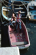 Lee Hill and Symond In a Boat, Dorset, UK, 1980s.