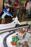 Visitors watch Santa's Christmas Train during the Christmas Gathering at Polen Farm in Kettering, Sunday, December 25, 2011.