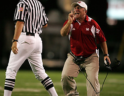 Memorial head coach Gary Koch argues with an official late in the fourth quarter of their 27-17 loss to the Westfield Mustangs, Friday, September 3, 2010 at George Stadium in Spring, TX.