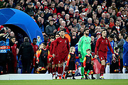 Liverpool captain Liverpool midfielder Jordan Henderson (14) leads the tem out for the Champions League Quarter-Final Leg 1 of 2 match between Liverpool and FC Porto at Anfield, Liverpool, England on 9 April 2019.