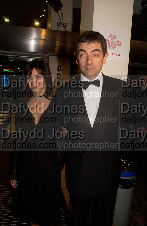 Rowan Atkinson and his wife Sutetra, Bright Young Things Royal European charity premiere in Leicester Sq. and party afterwards at  Claridges, 28 September 2003. © Copyright Photograph by Dafydd Jones 66 Stockwell Park Rd. London SW9 0DA Tel 020 7733 0108 www.dafjones.com