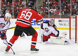 Feb 27, 2014; Newark, NJ, USA; Columbus Blue Jackets goalie Sergei Bobrovsky (72) makes a glove save on New Jersey Devils right wing Jaromir Jagr (68) during the first period at Prudential Center.