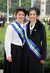 "UK Feminista photocall. 'Suffragettes' to descend on Parliament to lobby MP's for ""urgent action"" om women's equeslity.  Laura Pankhurst with her mother Dr. Helen Pankhurst, Granddaughter of suffragette leader Sylvia Pankhurst seen on Parliament Square outside the House of Commons, Wednesday October 24, 2012. Photo By i-Images"