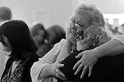"""Sept. 18, 2009 - Marie's daughter Marcie and her daughter Mysti weep as they sing along to """"Somewhere Over the Rainbow"""" during Marie's memorial service."""