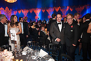 ELIZABETH HURLEY; DAVID FURNISH; SIR ELTON JOHN, Grey Goose character and cocktails. The Elton John Aids Foundation Winter Ball. off Nine Elms Lane. London SW8.  chef Marcus Wareing was in charge of dinner.30 October 2010. -DO NOT ARCHIVE-© Copyright Photograph by Dafydd Jones. 248 Clapham Rd. London SW9 0PZ. Tel 0207 820 0771. www.dafjones.com.