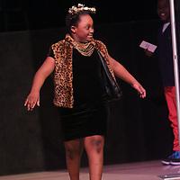 Taniya Harris walks the runway during the I Am Beautiful fashion show to benefit the Miracle League of Wilmington. (Jason A. Frizzelle)