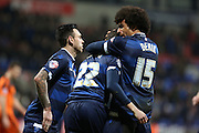 Bolton Wanderers defender Derik Osedeand Bolton Wanderers midfielder Mark Davies congratulate Bolton Wanderers striker Alves Wellington Silva after he wins a last minute penalty during the Sky Bet Championship match between Bolton Wanderers and Ipswich Town at the Macron Stadium, Bolton, England on 8 March 2016. Photo by Simon Brady.