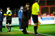 Exeter City manager Paul Tisdale argues with the assistant referee after Luton scores an injury time winner during the Sky Bet League 2 match between Exeter City and Luton Town at St James' Park, Exeter, England on 19 December 2015. Photo by Graham Hunt.