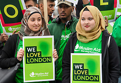 © Licensed to London News Pictures. 05/06/2017. London, UK. A group of young muslims representing Muslim Aid, attend a vigil at Potters Fields Park outside City Hall in London for those who lost their lives in the London Bridge terror attack. Three men attacked members of the public  after a white van rammed pedestrians on London Bridge. Ten people including the three suspected attackers were killed and 48 injured in the attack. Photo credit: Ben Cawthra/LNP