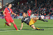 Cambridge United defender Mark Roberts  clears from York City forward, on loan from Oldham Athletic, Rhys Turner during the Sky Bet League 2 match between York City and Cambridge United at Bootham Crescent, York, England on 3 October 2015. Photo by Simon Davies.