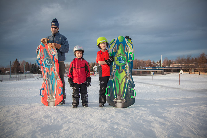 Jon with his sons on the sledding hill at Inlet View Elementary School in Anchorage's South Addition neighborhood