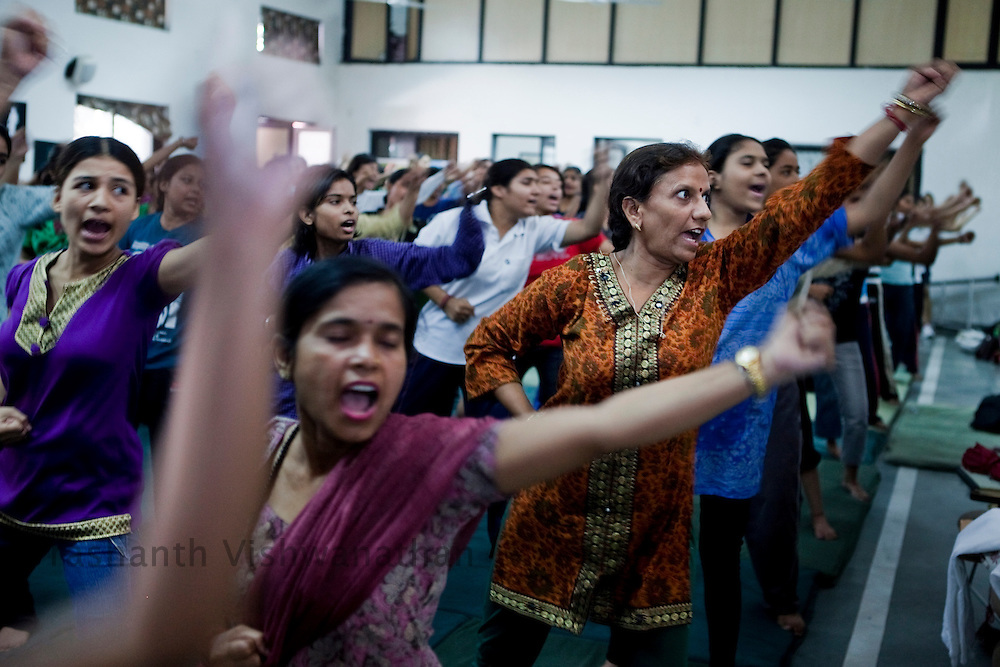 46 year old Rama Aggarwal ( in brown) a housewife and a yoga teacher, participates in a summer camp on self defence training an initiative by the Delhi Police and Special Police Unit for Women and Children at a police station hall in New Delhi, India, on Friday, June 6, 2011. Rama Aggarwal said she was preparing herself against any miscreants who could enter her house posing as a salesperson or a courier boy since she would have to be alone in the house in a few years time.  Photographer: Prashanth Vishwanathan/HELSINGIN SANOMAT