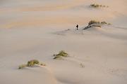 Photographer photographing the sand dunes on the John Dellenback Trail, Oregon Dunes National Recreation Area.