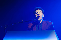 &copy; Licensed to London News Pictures. 28/03/2014. London, UK.   Metronomy performing live at Brixton Academy to promote their latest album Love Letters. In this picture - Joseph Mount.  Metronomy are an english electronic music group consisting of members Joseph Mount (vocals, Guitar, keyboard),<br /> Oscar Cash (keyboards/sax), Anna Prior (bass), Olugbenga Adelekan (drums).   Photo credit : Richard Isaac/LNP