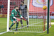 1 Josh Vickers for Lincoln City watches the ball hit the back of his net after a header from 7 Chris Porter for Crewe Alexander during the EFL Sky Bet League 2 match between Crewe Alexandra and Lincoln City at Alexandra Stadium, Crewe, England on 26 December 2018.