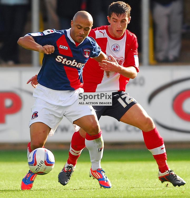 Joe Walsh (Crawley Town, red) and Danny Cadamarteri. .Carlisle v Crawley, Npower League One, 29th September 2012..(c)  Alex Todd | StockPix.eu
