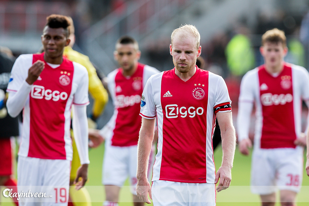 ROTTERDAM - Excelsior - Ajax , Voetbal , Seizoen 2016/2017 , Eredivisie , Stadion Woudestein , 19-03-2017 , eindstand 1-1 , Ajax speler Mateo Cassierra (l) Ajax speler Hakim Ziyech (2e l) Ajax speler Davy Klaassen (2e r) en Ajax speler Matthijs de Ligt (r) lopen teleurgesteld weg