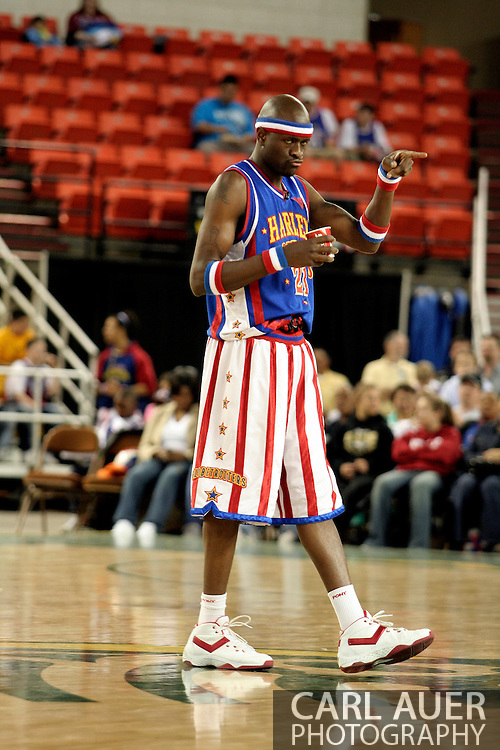 "04 May 2006: Kevin ""Special K"" Daley heads over to the fans with a cup of water for a rest during the Harlem Globetrotters vs the New York Nationals at the Sulivan Arena in Anchorage Alaska during their 80th Anniversary World Tour.  This is the first time in 10 years that the Trotters have visited Alaska."