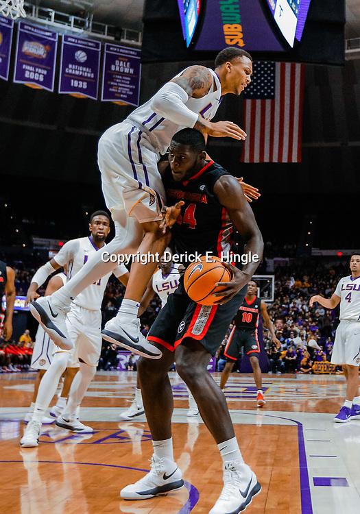 Jan 16, 2018; Baton Rouge, LA, USA; Georgia Bulldogs forward Derek Ogbeide (34) collides with LSU Tigers guard Brandon Sampson (0) during the first half at the Pete Maravich Assembly Center. Mandatory Credit: Derick E. Hingle-USA TODAY Sports