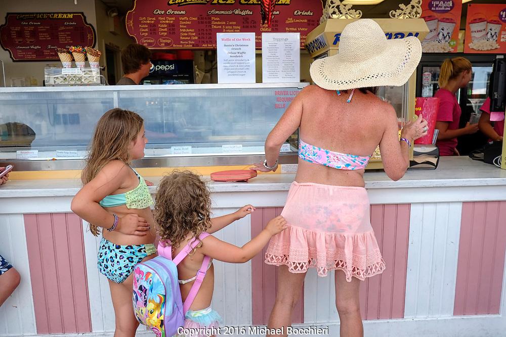 POINT PLEASANT BEACH, NJ - July 26: Children and their mother order ice cream at Jenkinson's Boardwalk on July 26, 2016 in POINT PLEASANT BEACH, NJ.  (Photo by Michael Bocchieri/Bocchieri Archive)