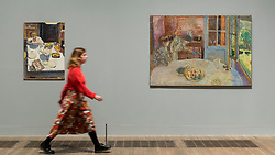 "© Licensed to London News Pictures. 21/01/2019. LONDON, UK. A staff member walks by (L to R) ""The Table"", 1925, and ""The Dining Room, Vernon"", 1925, both by Pierre Bonnard Preview of an exhibition called ""Pierre Bonnard: The Colour of Memory"" at Tate Modern.  This is the UK's first major Pierre Bonnard exhibition in 20 years bringing together around 100 of his works from around the world covering a period from 1912 to his death in 1947.  The works are on show 23 January to 6 May 2019.  Photo credit: Stephen Chung/LNP"