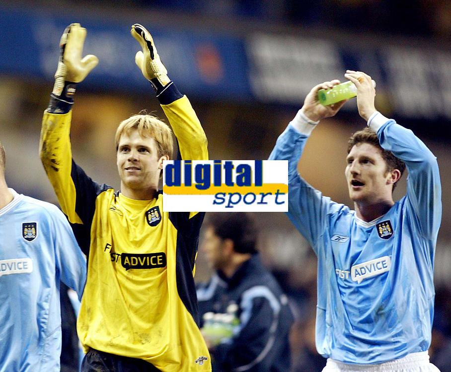 Photograph: Scott Heavey.<br /> Tottenham Hotspur v Manchester City. FA Cup Fourth Round Replay. 04/02/2004.<br /> Jon Macken (R) and Arni Arason applaud the travelling fans