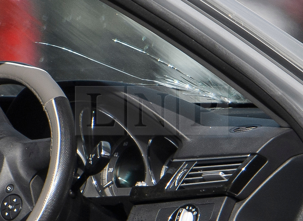 © Licensed to London News Pictures. 13/04/2019. London, UK. A bullet hole in the front windscreen of a car at the scene in Holland Park after shots were fired near the Ukrainian embassy. Photo credit: Ben Cawthra/LNP