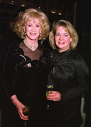 Left to right, the DUCHESS OF ST.ALBANS and her daughter MRS SUSIE SANDERS, at a party in London on 23rd March 1998.MGH 43