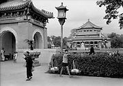 C003-29a Tom Hutchins_Sun Yat-Sen memorial, (Boy carrying baskets in foreground) Canton (Guangzhou) 1956.tif