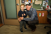 Annual Bicycle No Cavity winner receives his bike at Dr. Rabitz Pediatric Dentistry in San Jose, California, on November 23, 2015. (Stan Olszewski/SOSKIphoto)