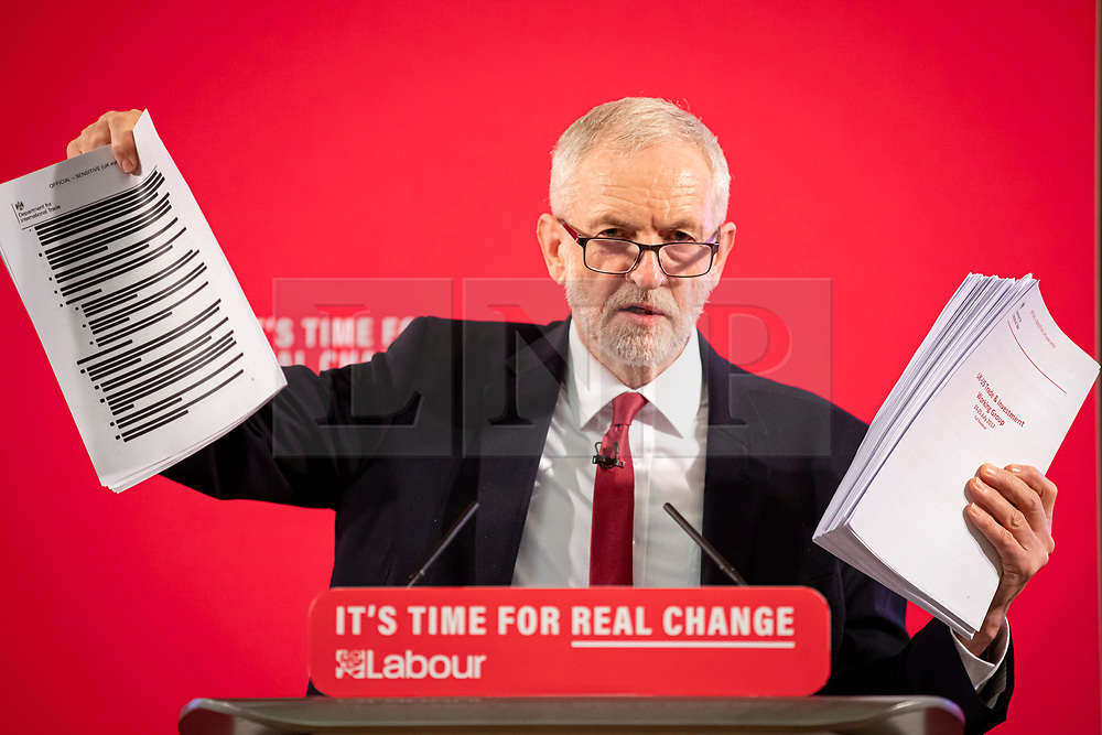 © Licensed to London News Pictures. 27/11/2019. London, UK. Leader of the Labour Party Jeremy Corbyn holds up a redacted and unreacted copy of a report on trade negotiations with the United States that may affect the NHS at an event in Westminster. Photo credit: Rob Pinney/LNP