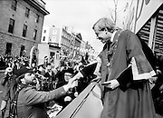 'Bottler', aka comedian Brendan Grace, greets the Lord Mayor at the reviewing stand.<br /> 17 March 1982