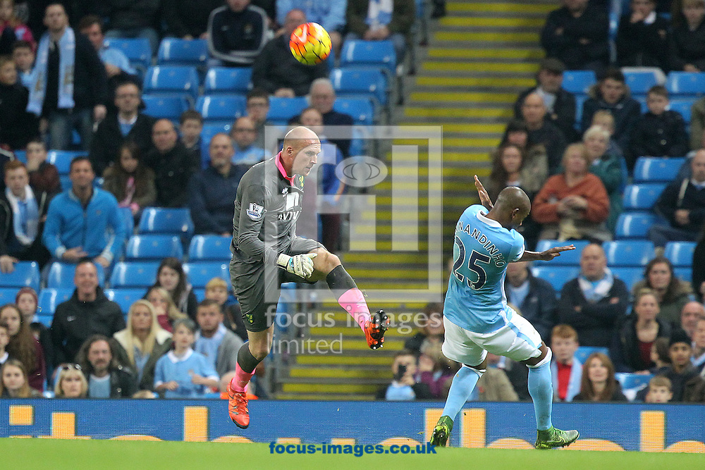 John Ruddy of Norwich clears the ball ahead of Fernandinho of Manchester City during the Barclays Premier League match at the Etihad Stadium, Manchester<br /> Picture by Paul Chesterton/Focus Images Ltd +44 7904 640267<br /> 31/10/2015