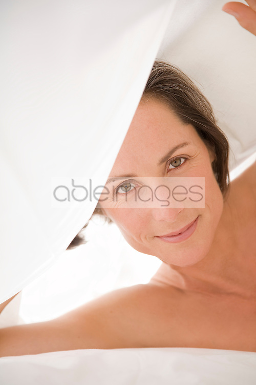 Close up of woman holding bed sheet
