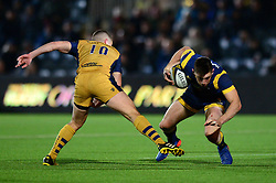 Josh Adams of Worcester Warriors is challenged by Billy Searle of Bristol Rugby - Mandatory by-line: Dougie Allward/JMP - 04/11/2016 - RUGBY - Sixways Stadium - Worcester, England - Worcester Warriors v Bristol Rugby - Anglo Welsh Cup