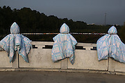 ANQING, CHINA - NOVEMBER 22: (CHINA OUT) <br /> <br /> Students Dry there Quilts On Bridge Columns<br /> <br /> Students of Anqing Normal University Longshan Campus shine their quilts on bridge columns on November 22, 2014 in Anqing, Anhui province of China. Quilts shined on bridge columns looked like fat Teru teru bozu dolls, little traditional handmade dolls made of white paper or cloth that Japanese farmers began hanging outside of their window by a string. <br /> ©Exclusivepix Media