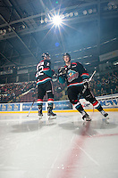 KELOWNA, CANADA - OCTOBER 18:  MacKenzie Johnston #22 and Damon Severson #7 of the Kelowna Rockets take part in a pre-game ritual on the ice as the Prince George Cougars visit the Kelowna Rockets on October 18, 2012 at Prospera Place in Kelowna, British Columbia, Canada (Photo by Marissa Baecker/Shoot the Breeze) *** Local Caption ***
