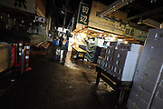 after hours, sorting and distribution area at Tsukiji Wholesale Fish Market,  Tokyo, Japan.