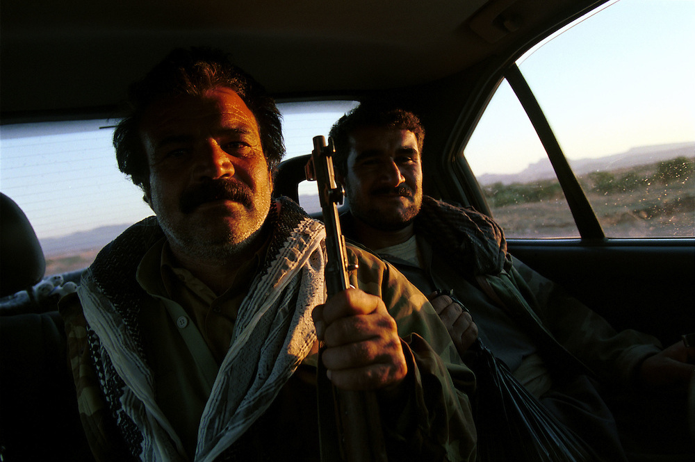 "Hitch hikers. Kurdish Peshmerga (which means ""those who face death"") fighters patrol along the military road where Ansar al-Islam Islamic extremists are active...Halabja, Iraqi Kurdistan. 20/11/2002...Photo © J.B. Russell"