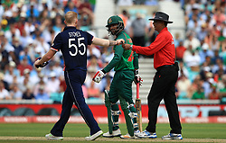 England's Ben Stokes speaks with Bangladesh's Tamim Iqbal during the ICC Champions Trophy, Group A match at The Oval, London.