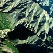 20 May 1976<br /> Folded ridges with settlements on two levels. Green fields in valley below.