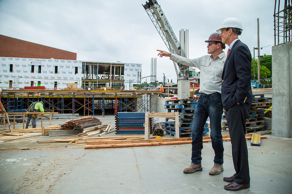 Photograph of David Swain and Peter Lane in front of a new parking deck and new offices for the Walton Arts Center on Dickson Street in Fayetteville, Arkansas on May 13, 2015<br /> <br /> Photography by Wesley Hitt