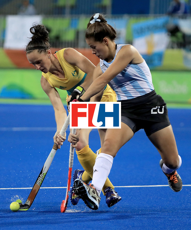 RIO DE JANEIRO, BRAZIL - AUGUST 11:  Madonna Blyth #12 of Australia attempts to run past Lucina Von der Heyde #20 of Argentina during a Women's Preliminary Pool B match at the Olympic Hockey Centre on August 11, 2016 in Rio de Janeiro, Brazil.  (Photo by Sam Greenwood/Getty Images)