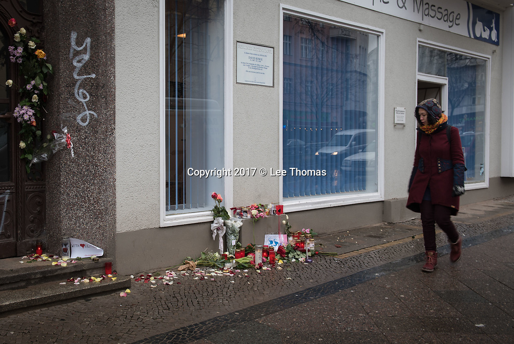 "155 Hauptstrasse, Schöneberg, Berlin, Germany. 11th January 2018.  Two years after David Bowie's death, fans in Berlin keep the British musician's fame alive with lit candles, flowers and messages of appreciation. The shrine has been made outside the building he shared with Iggy Pop in the late 1970s. In the three years Bowie lived in West Berlin he recorded the ""Berlin Trilogy"", Low (1977), Heroes (1977), and Lodger (1979).   // Lee Thomas, Tel. 07784142973. Email: leepthomas@gmail.com  www.leept.co.uk (0000635435)"