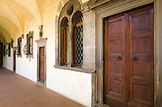 Door and window in the Canon's Cloister, Basilica di San Lorenzo, Florence, Tuscany, Italy
