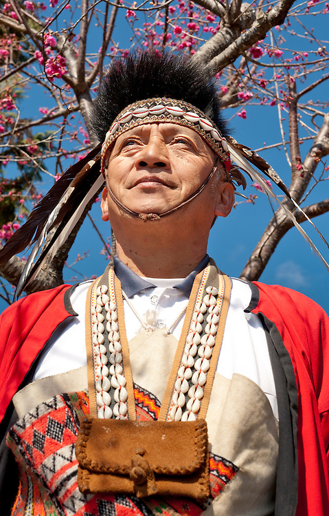 A Zhou tribesman poses in traditional clothing for tourists. Alishan Township,Chia Yi County, Taiwan