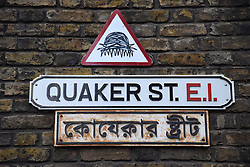 Quaker Street on corner of Brick Lane, Spitalfields, London. Borough of Tower Hamlets. Sign is in English & Bengali.